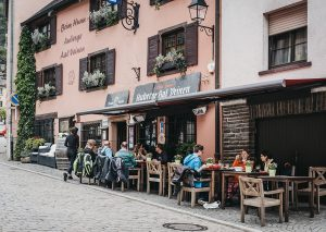 luxemburg restaurang 300x213 - Vianden, Luxembourg - May 18, 2019: People Sitting At The Outdoo